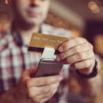 Man using square for a credit card payment