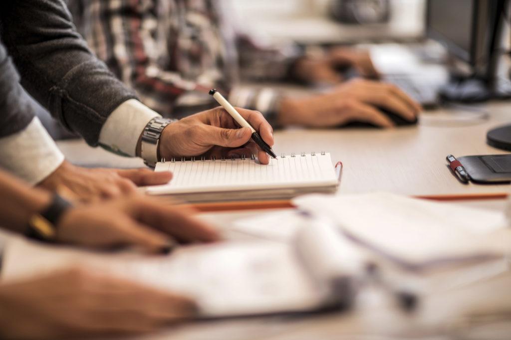 man writing a business plan