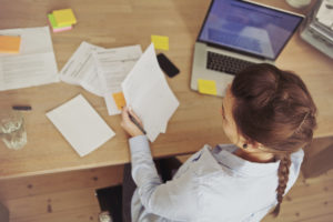 Businesswomen reviewing paperwork